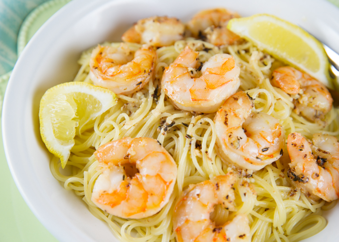 Serve the lemony garlicky shrimp over a bed of pasta and top it off ...